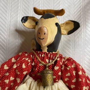 Cow raggedy and wood doll with cow bell signed.
